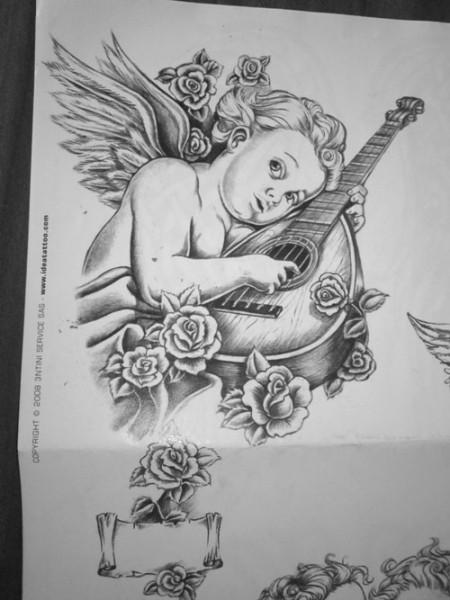 kathi284 musikalischer engel tattoos von tattoo. Black Bedroom Furniture Sets. Home Design Ideas