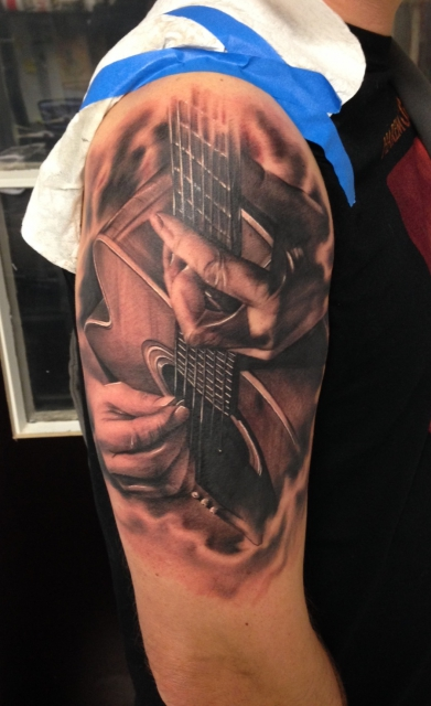 gitarre-Tattoo: Guitar Player