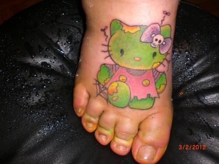 Hello kitty lip tattoo