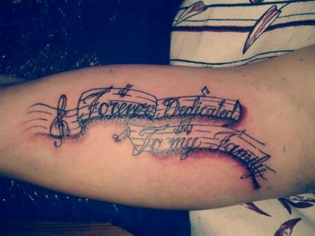 notenzeile tattoo