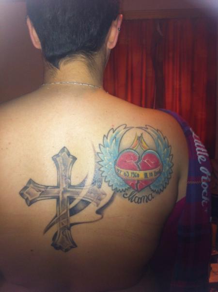 Herz mit Flügeln und Kreuz
