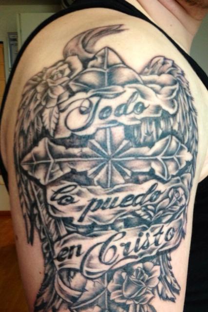 houser: Kreuz mit Flügeln | Tattoos von Tattoo-Bewertung.de