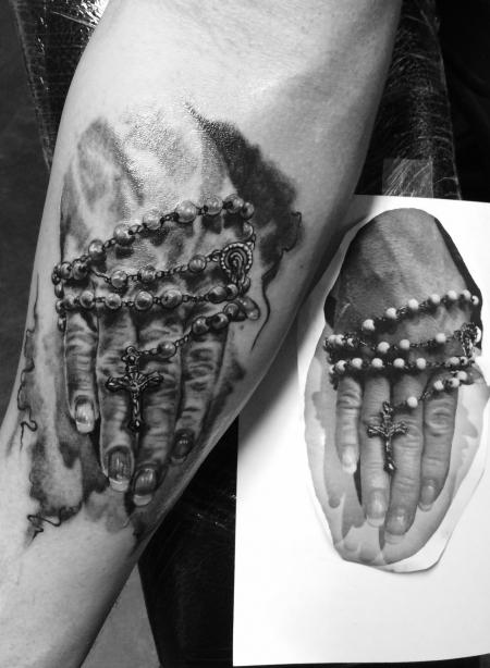 Bettende Hand
