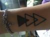 Kleines symmetrisches Tattoo