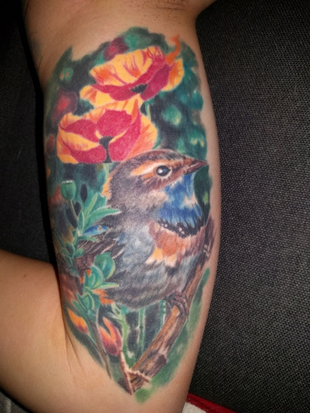 Innenarm Vogel Mohnblumen