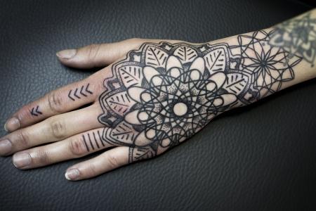 Geometric Dotwork Mandala Hand Tattoo
