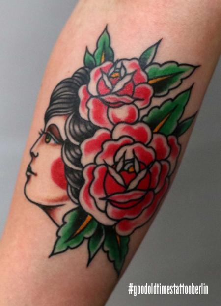 traditional flower girl tattoo