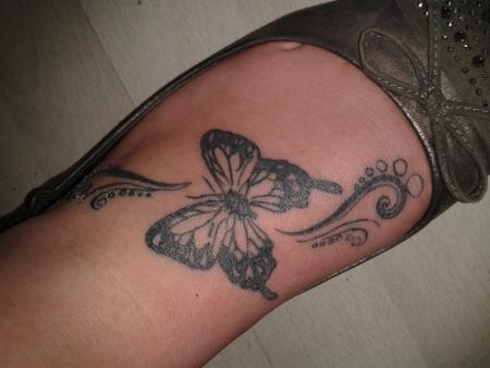 Schmetterling auf Fuß