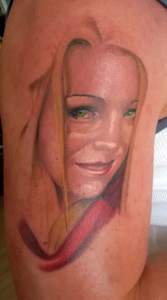 Oberarm Tattoo